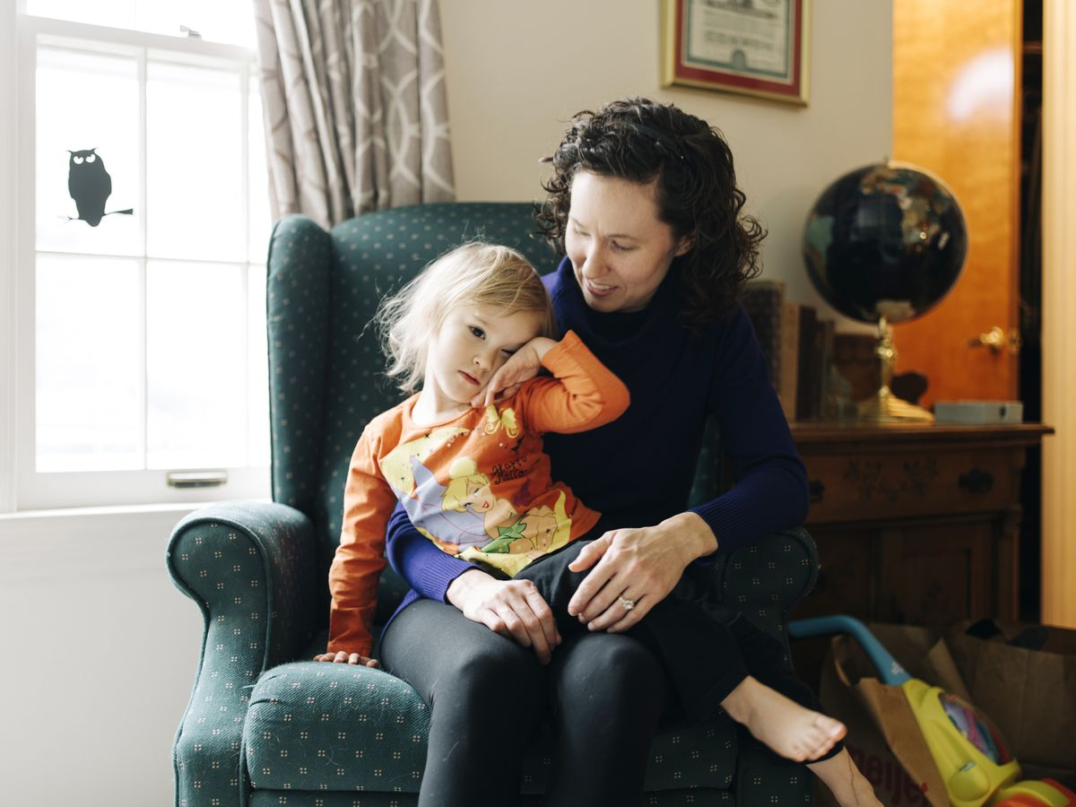 Tammy Cooper sits with her 3-year-old daughter, Jillian, at their Parchment, Mich., home. (Photo for The Washington Post by David Kasnic)