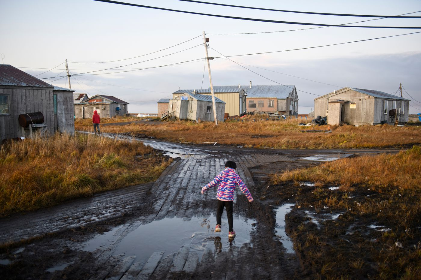 Sections of land hold standing water in Newtok. Newtok's system of boardwalks have been damaged as permafrost has melted and areas of the village have been prone to flooding. (Marc Lester / ADN)