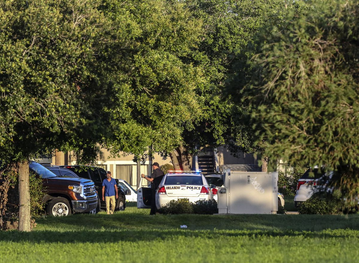 Orlando police continue at the scene of a hostage standoff where four children and the suspect died and a police officer was shot. (Jacob Langston/Orlando Sentinel/TNS)