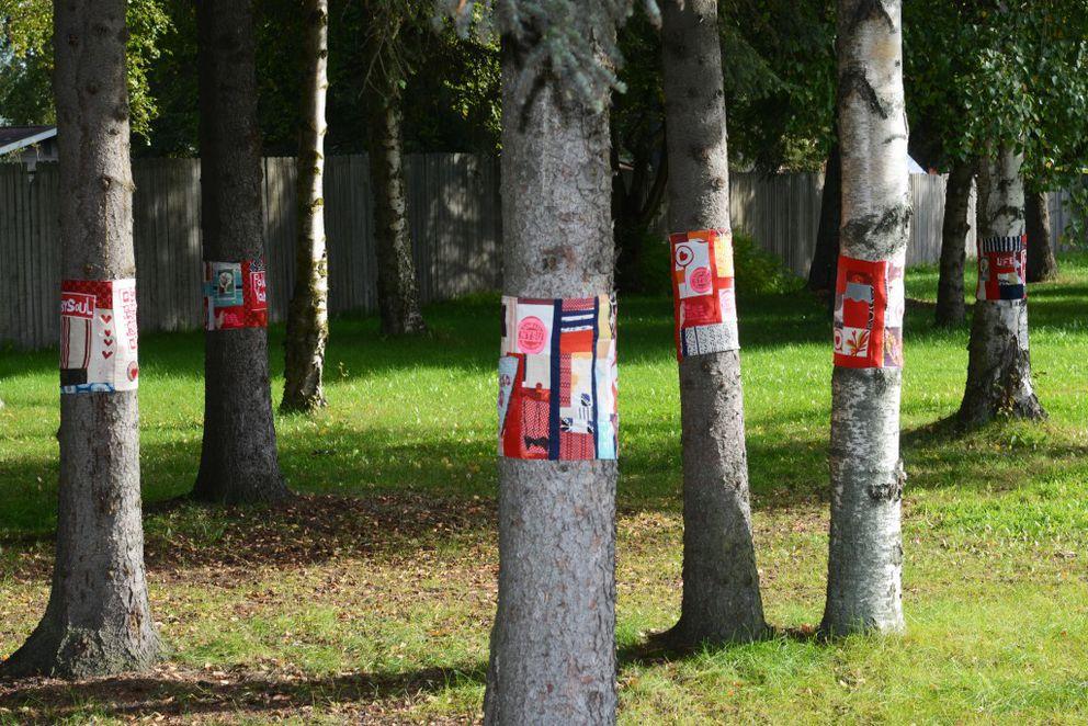Fabric art adorns about a dozen trees along West Northern Lights Boulevard on Friday, September 9, 2016, in Turnagain. (Erik Hill / Alaska Dispatch News)