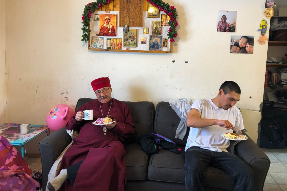 Moses Gabriel and Brent Paukan eat brunch after Sunday service. Gabriel is a retired Russian Orthodox priest, and Paukan was visiting from St. Mary's for a basketball tournament. (Loren Holmes / ADN)