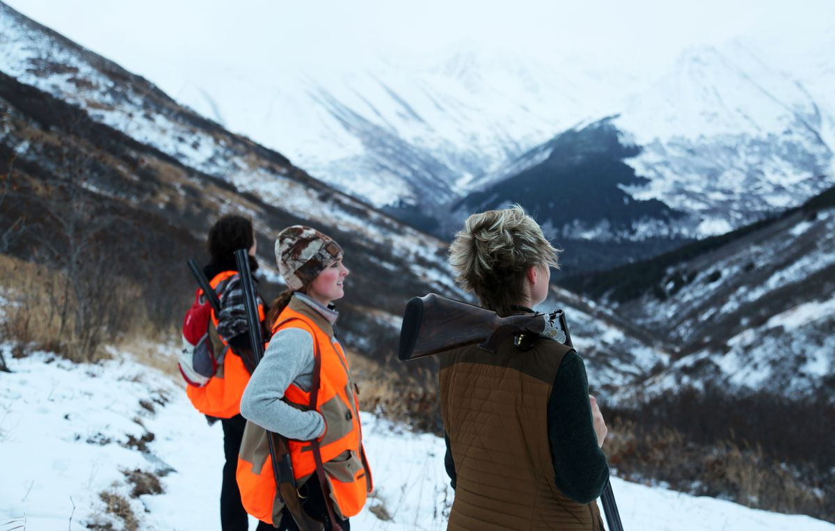 Women hunters new to upland hunting join Christine Cunningham, right, in searching the Kenai Mountains for ptarmigan in 2014. In Alaska, females purchase roughly 20 percent of the total resident hunting licenses issued in the state, making one in five Alaska hunters female. This number represents a higher percentage of female hunters than the national average of 11 percent. (Steve Meyer)