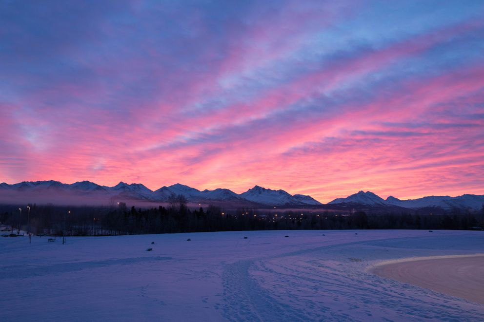 The sun rises over the Chugach mountains in December 2017. (Loren Holmes / ADN)
