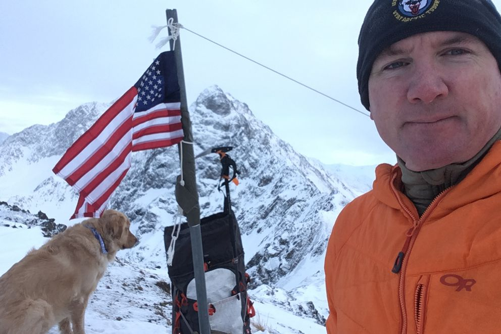 Kirk Alkire stands atop Mt. POW/MIA after replacing the flag in Dec. 2017. The Chugach peak is in the Eklutna area. (Photo provided by Kirk Alkire)