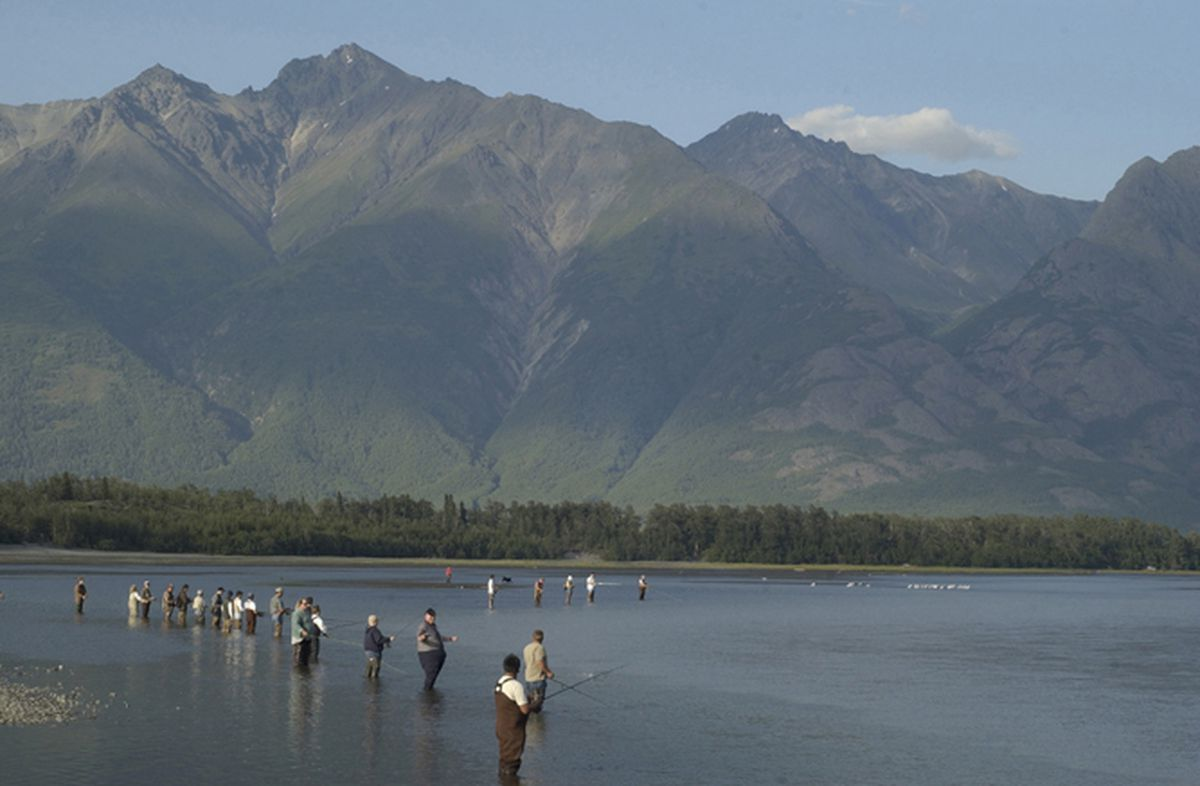 Anglers line the Knik River near the mouth of Jim Creek to fish for silver salmon on Thursday evening, August 7. (Stephen Nowers/Anchorage Daily News)