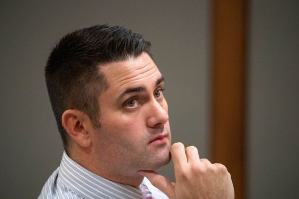 Anchorage dentist Seth Lookhart listens to his lawyer Paul Stockler question a witness Tuesday, Dec. 3, 2019 during his trial for Medicaid fraud and