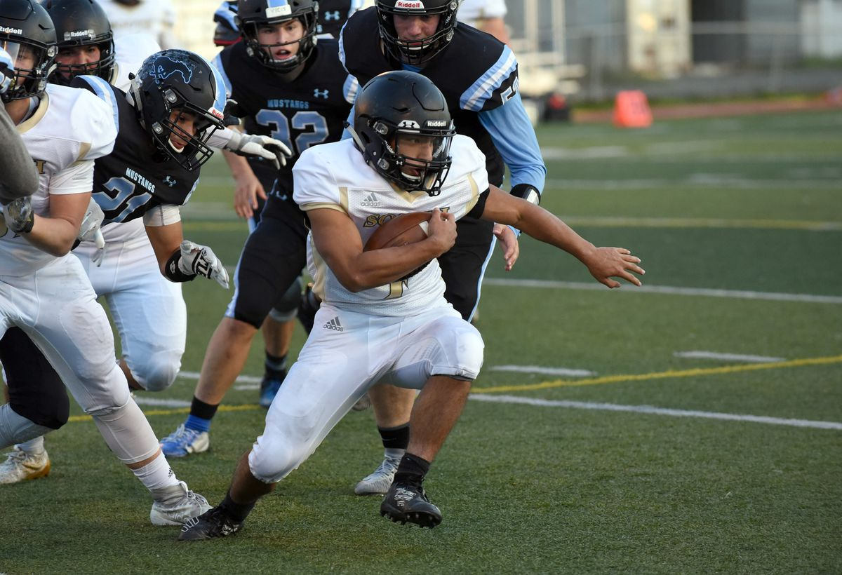 South's Carter Weber-Thomas looks for running room during South's 39-14 win over Chugiak last weekend. (Matt Tunseth / Chugiak-Eagle River Star)