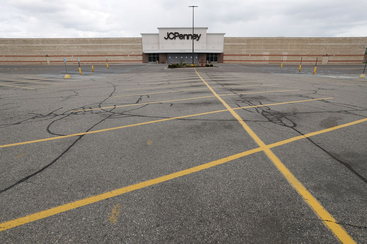 FILE - This May 8, 2020 file photo shows an empty parking lot at a JC Penney store in Roseville, Mich. U.S. retail sales tumbled 16.4% from March to April as business shutdowns caused by the coronavirus kept shoppers away, threatened stores across the country and weighed down a sinking economy. (AP Photo/Paul Sancya, File)