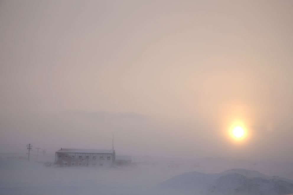 In this Feb. 13, 2019, photo, the afternoon sun hangs low as it shines through the snow at the airport in Nome, Alaska. (AP Photo/Wong Maye-E)