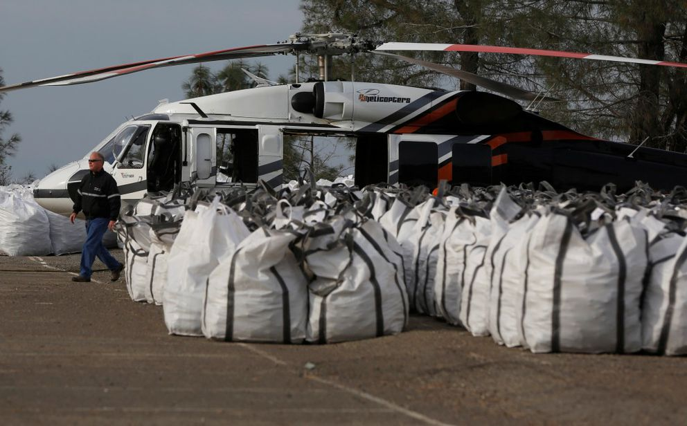 Rock is prepped to be used on the Lake Oroville Damspillway after an evacuation was ordered for communities downstream from the dam, in Oroville, California, February 13, 2017. REUTERS/Jim Urquhart