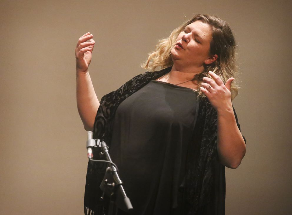 Soprano Kara Guggenmos sings while recording her piece for the concert. (Emily Mesner / ADN)