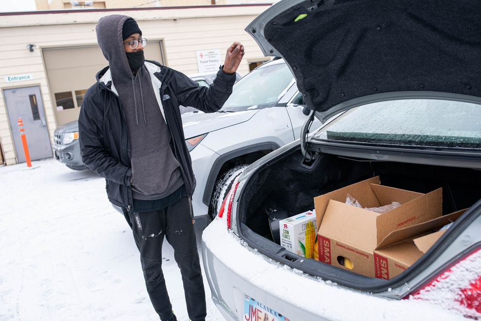Dave Sosa closes the trunk to his car after picking up food on Friday, Nov. 6, 2020 from the Lutheran Social Services food pantry in Spenard. (Loren Holmes / ADN)