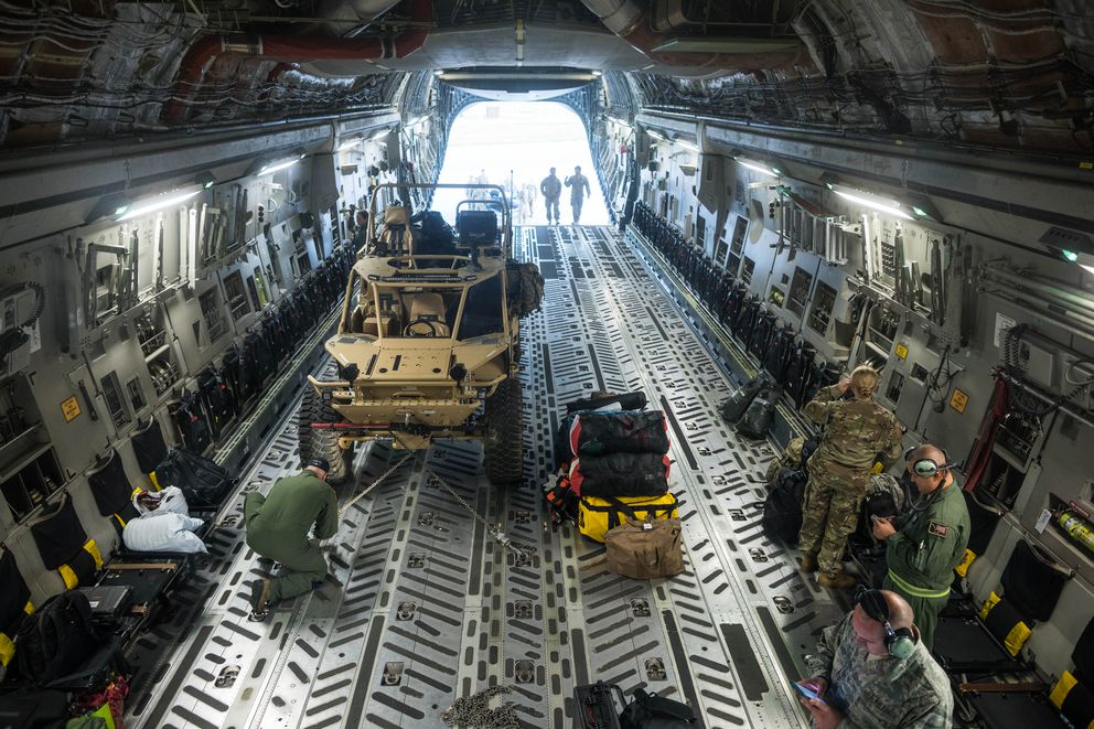 A Guardian Angel air-deployable rescue vehicle is loaded onto an Alaska Air National Guard C-17 Wednesday morning at JBER. (Loren Holmes / ADN)