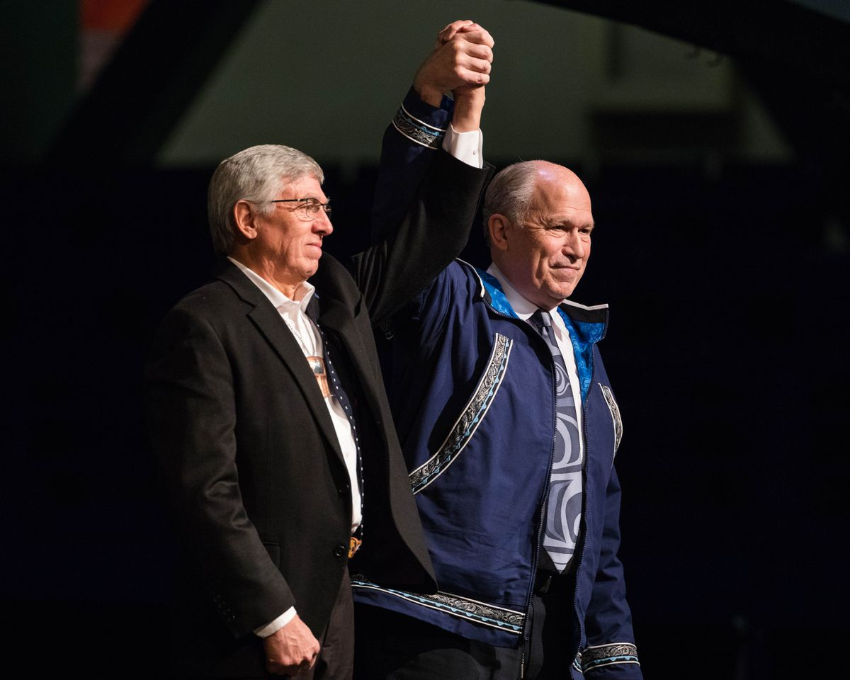 Alaska Gov. Bill Walker, right, takes the stage with Lt. Gov. Byron Mallott at last year's Alaska Federation of Natives convention in Fairbanks. (Loren Holmes / Alaska Dispatch News)
