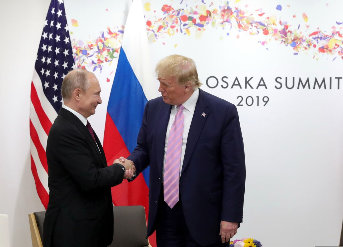 U.S. President Donald Trump, right, and Russian President Vladimir Putin greet each other during a bilateral meeting on the sidelines of the G-20 summit in Osaka, Japan, Friday, June 28, 2019. (Mikhail Klimentyev, Sputnik, Kremlin Pool Photo via AP)