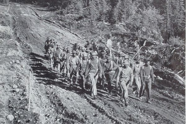 Black U.S. Army engineers march back to camp after a day of work building the Alaska Highway in 1942. About a third of the 10,000 men who built the highway were engineers in segregated all-black units. (Courtesy Katie Ringsmuth)