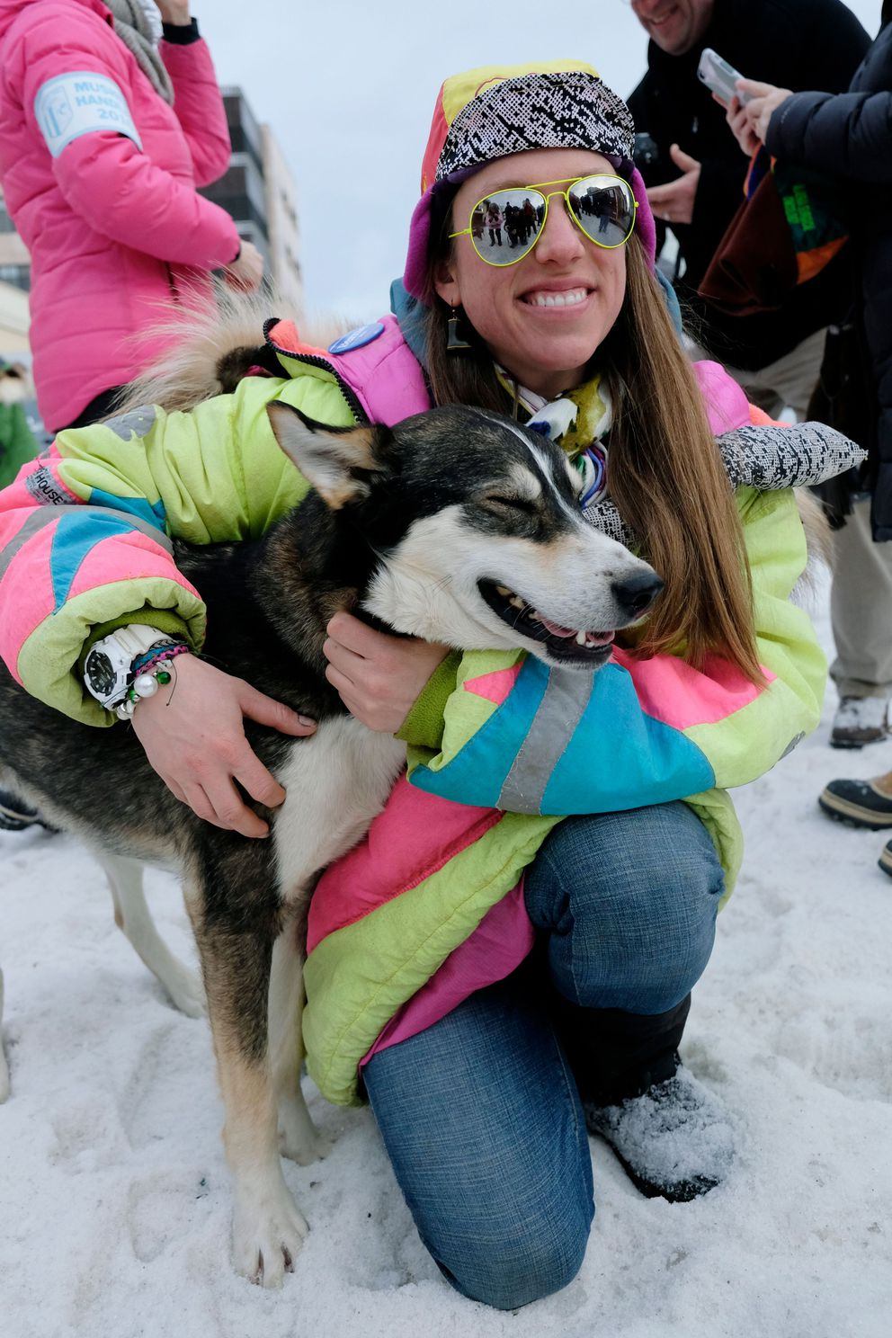 Monica Zappa holds her dog Dweezil. Dogs and mushers representing 85 teams ran through Anchorage for the ceremonial start of the Iditarod Trail Sled Dog Race on Saturday, March 5, 2016. (Marc Lester / ADN archive 2016)