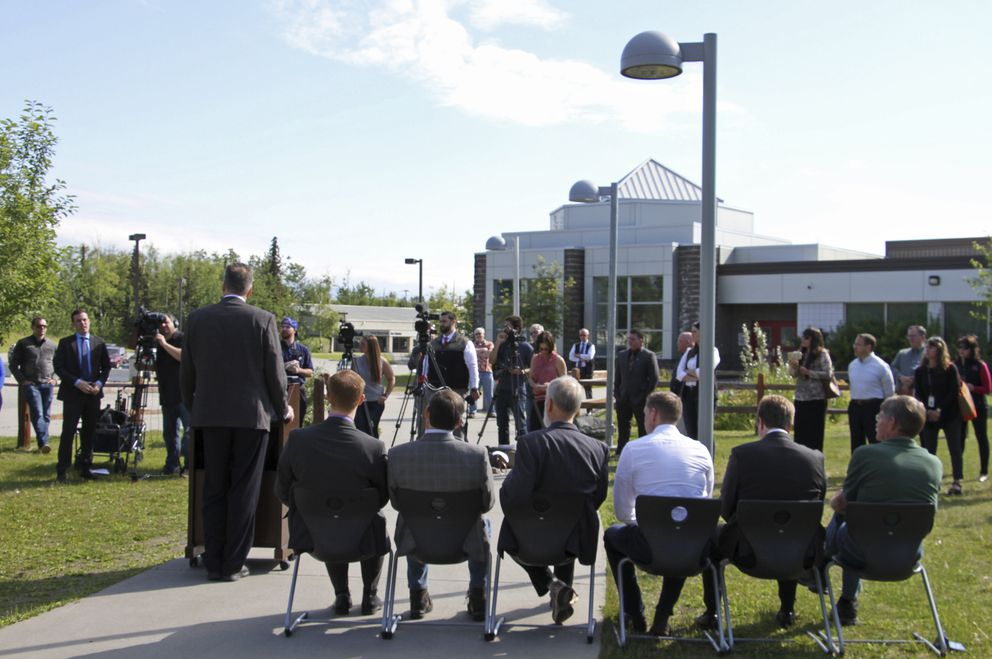 Alaska Gov. Mike Dunleavy, standing at podium, speaks at a news conference Friday, June 14, 2019, in Wasilla. (AP Photo/Mark Thiessen)