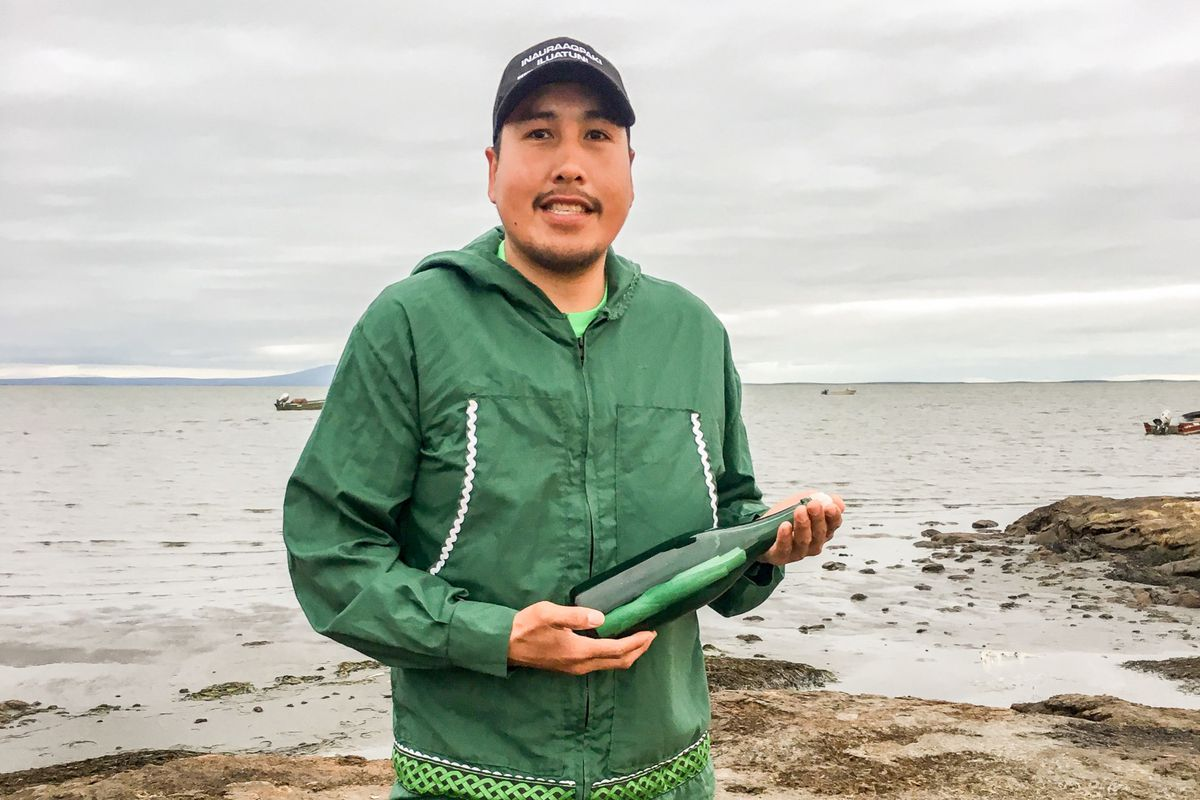Tyler Ivanoff holds the message-in-a-bottle he found near Shishmaref. (Photo courtesy Tyler Ivanoff)