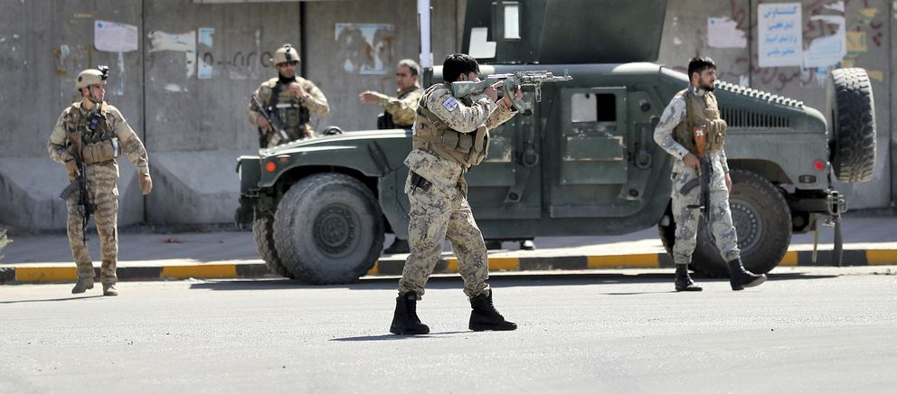 Afghan security forces guard the site of a suicide attack near the U.S. Embassy in Kabul, Afghanistan, Tuesday, Sept. 17, 2019. Hours earlier Afghan officials said a suicide bomber rammed his motorcycle packed with explosives into the entrance to a campaign rally of President Ashraf Ghani in northern Parwan province, killing over 20 people and wounding over 30. Ghani was present at the venue but was unharmed. The Taliban have claimed both attacks. (AP Photo/Ebrahim Noroozi)