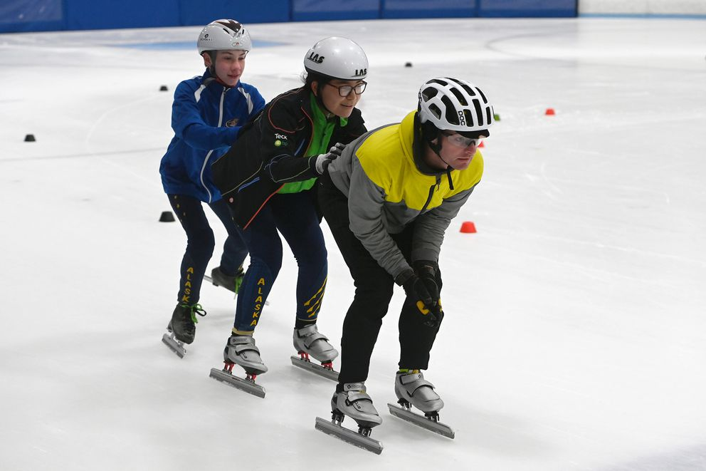James Williamson leads a group of skaters practicing a relay push. (Bill Roth / ADN)