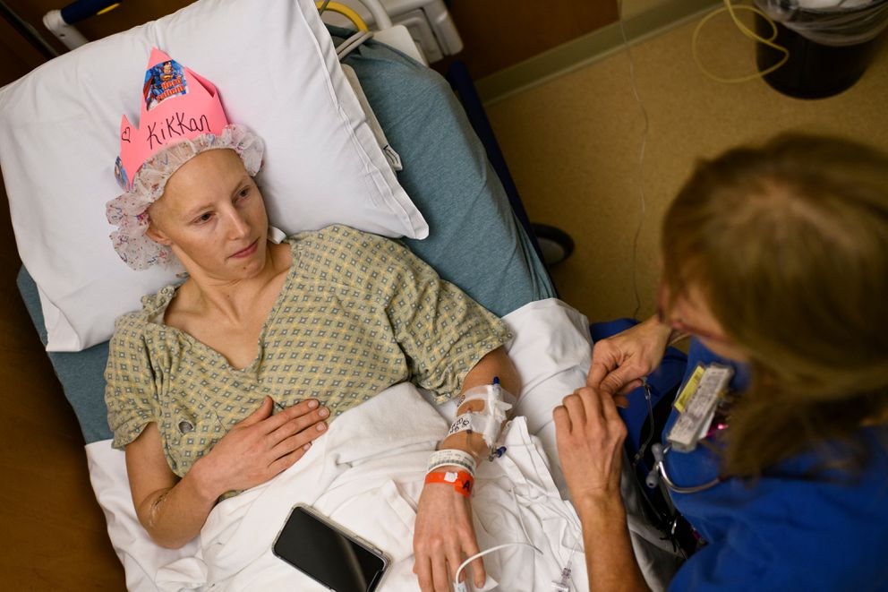 Nurse Linda Sandstrom, who made a pink crown for Kikkan Randall, talks with Randall before her lumpectomy surgery last November. (Marc Lester / ADN)