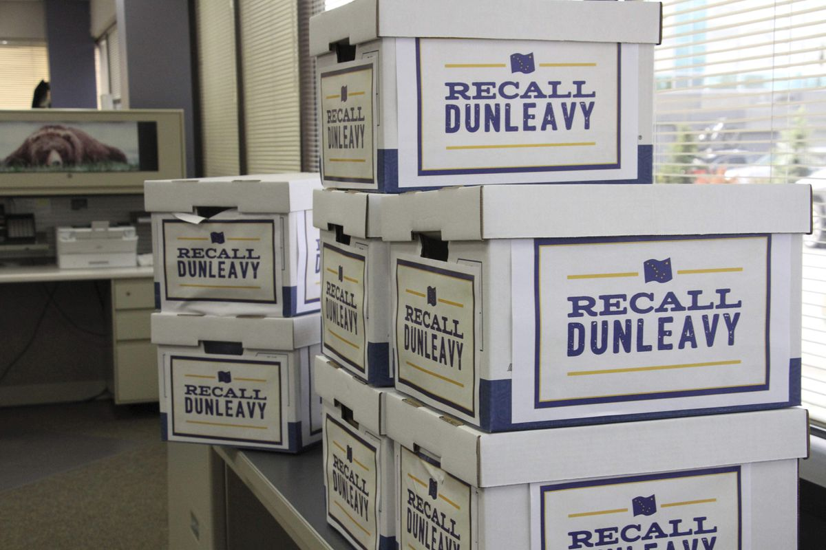Boxes of signatures collected to recall Alaska Gov. Mike Dunleavy are shown in the Alaska Division of Elections office Thursday, Sept. 5, 2019. Recall organizers say they submitted 49,006 signatures, a first step in an attempt to force the recall election of the first-term governor. (AP Photo/Mark Thiessen)