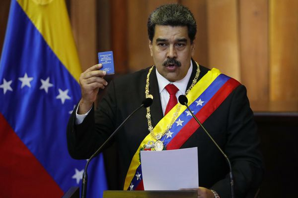FILE - In this Jan. 10, 2019, file photo, Venezuela's President Nicolas Maduro holds up a small copy of the constitution as he speaks during his swearing-in ceremony at the Supreme Court in Caracas, Venezuela. The coalition of Latin American governments that joined the U.S. in quickly recognizing opposition leader Juan Guaido as Venezuela's interim president, and not Maduro, came together during weeks of secret diplomacy. (AP Photo/Ariana Cubillos, File)
