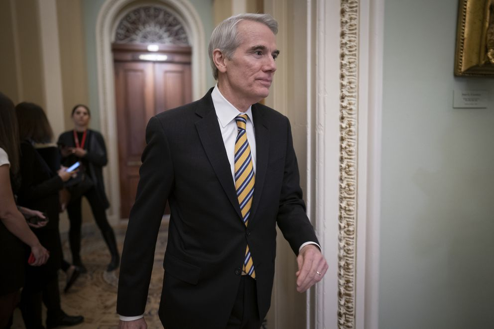 FILE - In this Jan. 31, 2020, file photo Sen. Rob Portman, R-Ohio, arrives as the first impeachment trial of President Donald Trump in Washington. Portman said Monday, Jan. 25, 2021, that he won't seek reelection and plans to end a career in federal government spanning more than three decades. (AP Photo/J. Scott Applewhite, File)