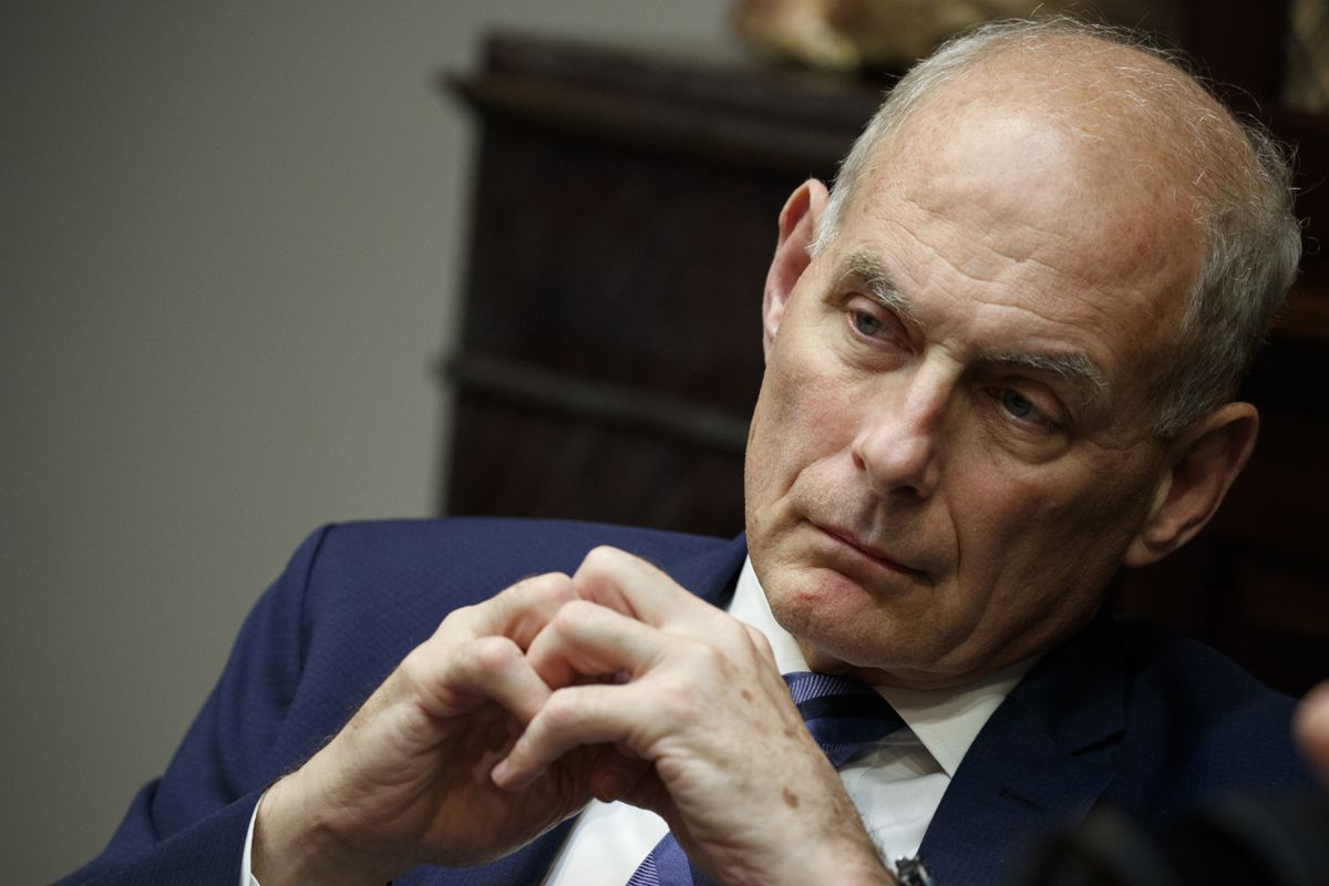 In this June 21, 2018 photo, White House chief of staff John Kelly listens as President Donald Trump speaks during a lunch with governors in the Roosevelt Room of the White House in Washington. Trump says chief of staff John Kelly will leave his job at the end of the year.(AP Photo/Evan Vucci)