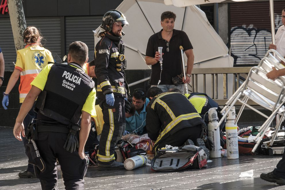 Paramedics tend to one of the many pedestrians struck by a van driving through crowds on Las Ramblas, Barcelona's most famous street, killing at least 12, on Aug. 17, 2017. At least 80 people were injured in what Spanish authorities described as a terrorist attack; two men have been arrested and the Islamic State group has already claimed responsibility. (Sergi Alcazar/El Nacional via The New York Times) -- NO SALES; FOR EDITORIAL USE ONLY WITH STORY SLUGGED BARCELONA-CRASH FOR AUG. 18, 2017. ALL OTHER USE PROHIBITED. —