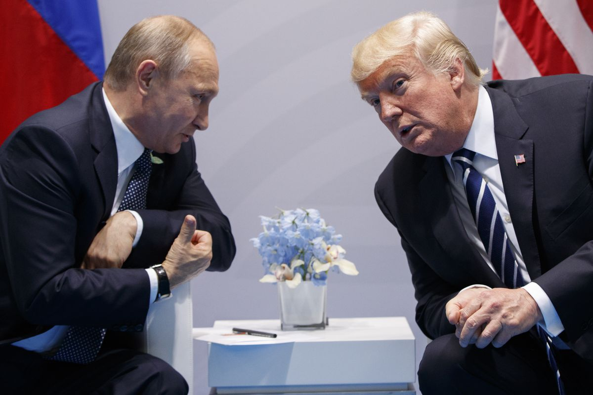 FILE - In this photo taken July 7, 2017, President Donald Trump meets with Russian President Vladimir Putin at the G-20 Summit, in Hamburg, Germany. (AP Photo/Evan Vucci, File)