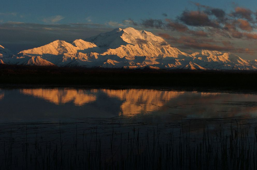 Denali is reflected in a small pond just east of Wonder Lake in Denali National Park on August 23, 2006. (Bob Hallinen / ADN archive)