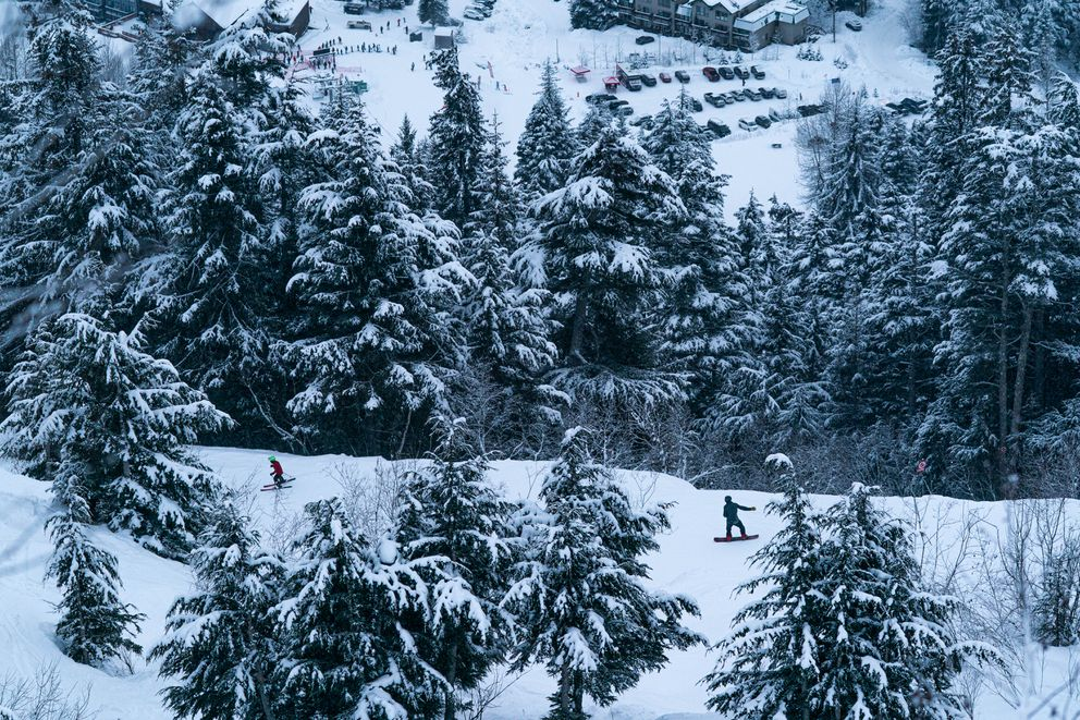 People ski and snowboard at Alyeska Resort on opening day, Friday, Dec. 18, 2020 in Girdwood. The resort has a number of new policies designed to limit the spread of COVID-19, including increased physical distancing and mandatory mask policies. (Loren Holmes / ADN)