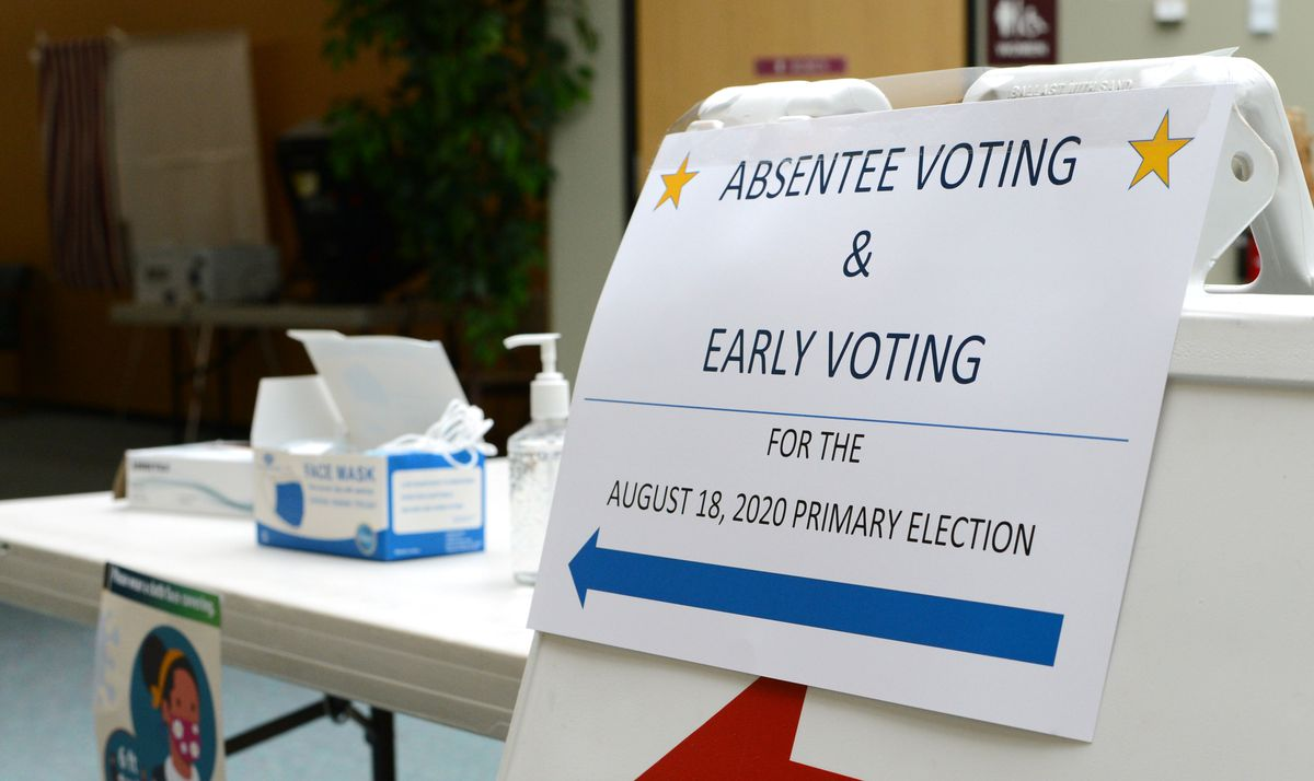 Early voting for Alaska's Aug. 18 statewide primary election opened on Monday, Aug. 3, 2020. At the District 1 early voting site in Juneau, a table of hand sanitizer, masks and gloves greeted voters. (James Brooks / ADN)