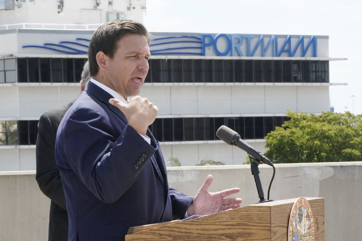 Florida Gov. Ron DeSantis speaks during a news conference, Thursday, April 8, 2021, at PortMiami in Miami. DeSantis announced a lawsuit against the federal government and the CDC demanding that cruise ships be allowed to sail. (AP Photo/Wilfredo Lee)