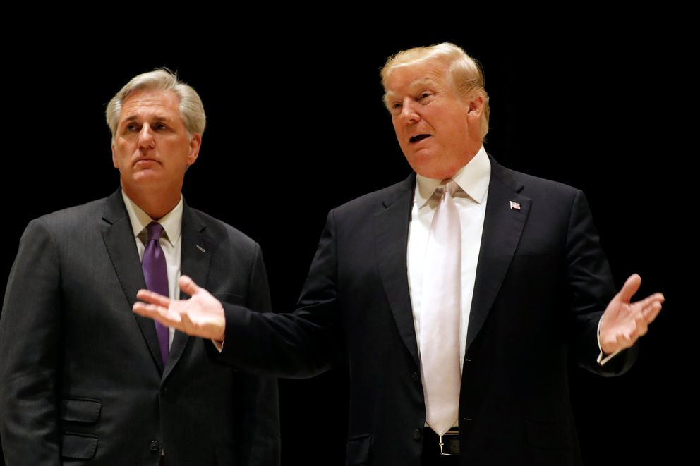 U.S. President Donald Trump speaks as he and House Majority Leader Kevin McCarthy arrive for dinner at Trump's golf club in West Palm Beach, Florida, U.S., January 14, 2018. REUTERS/Kevin Lamarque