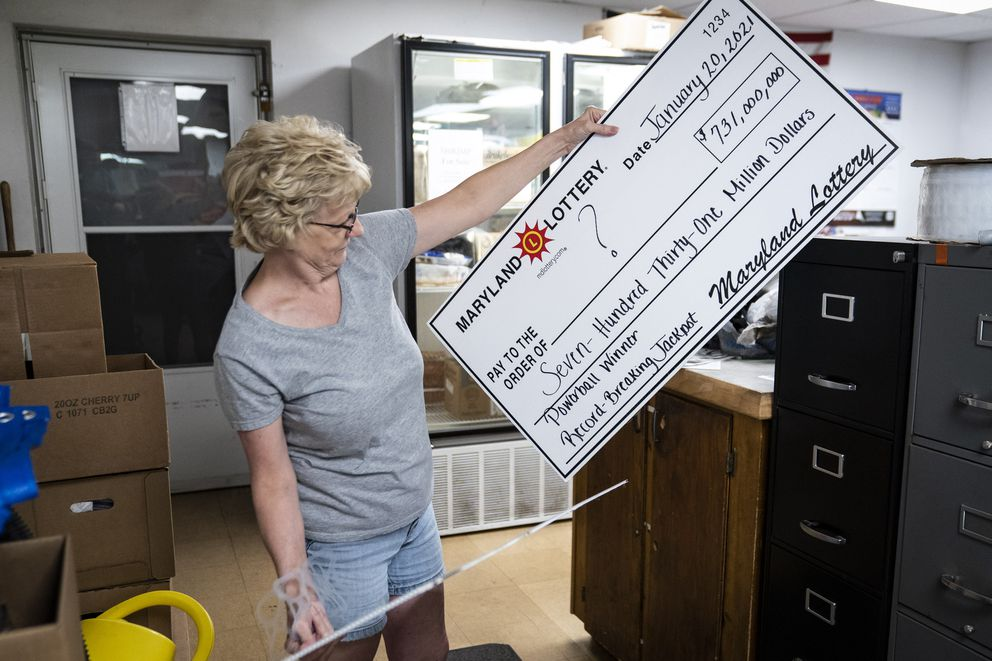 Manager Debbie Bennett shows off the symbolic winning check at Coney Market. Washington Post photo by Jabin Botsford.