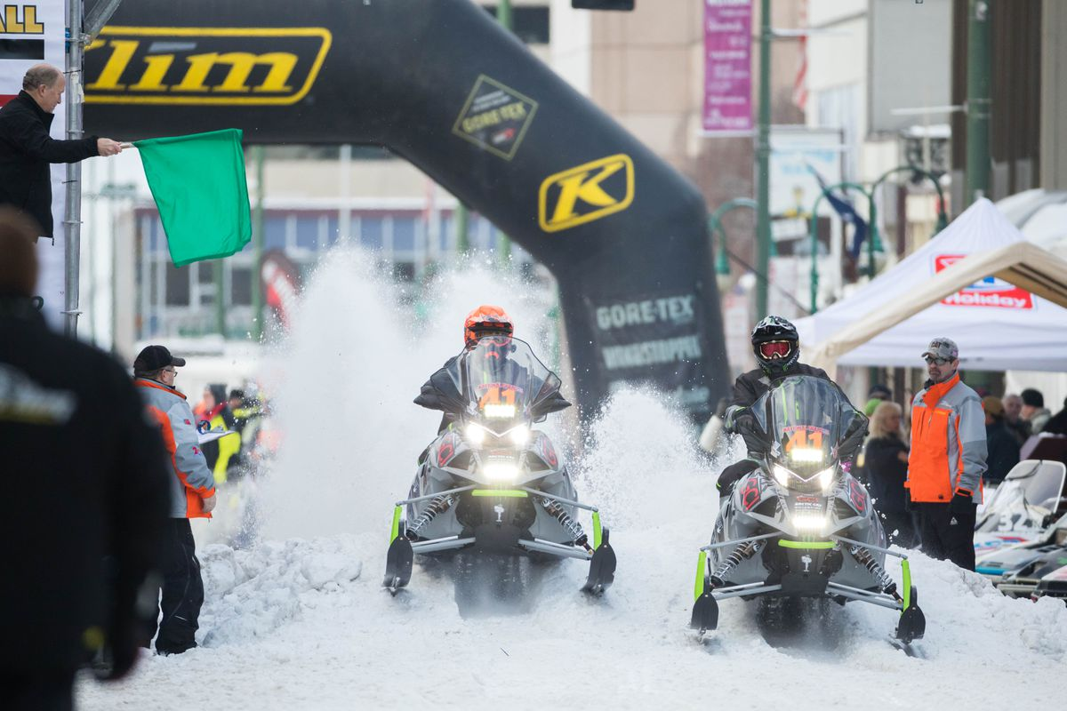 Cory Davis of Soldotna and Ryan Simons of Alberta leave the start line during the ceremonial start of the Iron Dog race on Feb. 18. With 300 miles to go on Friday, the duo was in position for a second-place finish. (Loren Holmes / Alaska Dispatch News)