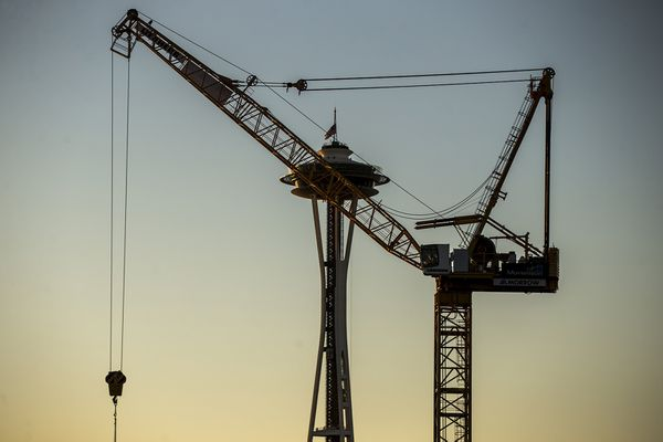 A South Lake Union crane obscures the Space Needle on Wednesday, Dec. 5, 2018. (Bettina Hansen/Seattle Times/TNS)