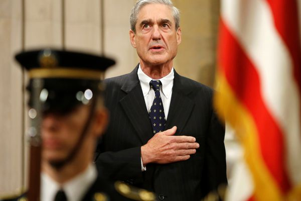 Outgoing FBI Director Robert Mueller stands for the national anthem during a farewell ceremony for him at the Justice Department in Washington, August 1, 2013. (Jonathan Ernst / Reuters file)