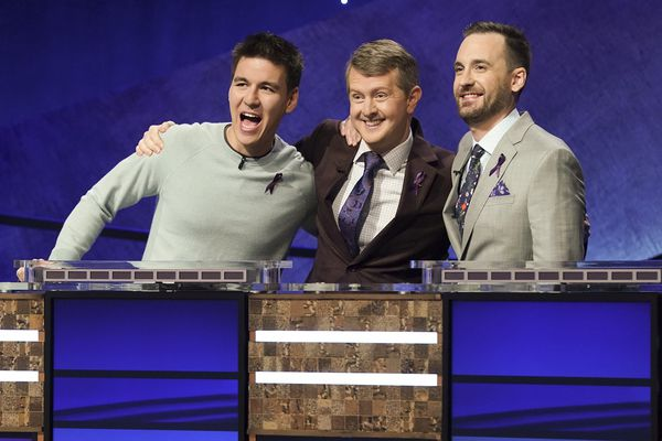 In this image released by ABC, contestants, from left, James Holzhauer, Ken Jennings and Brad Rutter appear on the set of