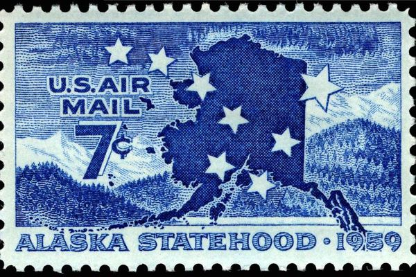 An image of a U.S. Post Office Alaska Statehood commemorative Air Mail stamp, issued in 1959. (U.S. Post Office, Smithsonian National Postal Museum)