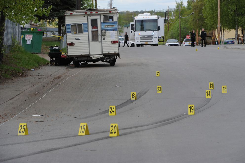 Anchorage Police investigate a shooting after people in two moving vehicles fired shots at each other in Fairview on Monday, May 21, 2018. (Bill Roth / ADN)