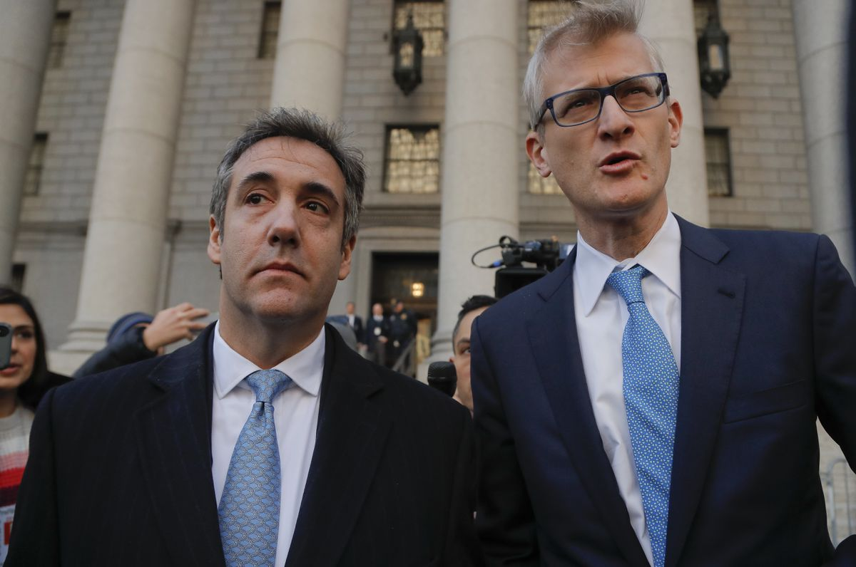 Michael Cohen, left, walks out of federal court with his attorney Guy Petrillo, Thursday, Nov. 29, 2018, in New York. Cohen, President Donald Trump's former lawyer, pleaded guilty to lying to Congress about work he did on an aborted project to build a Trump Tower in Russia. He told the judge he lied about the timing of the negotiations and other details to be consistent with Trump's