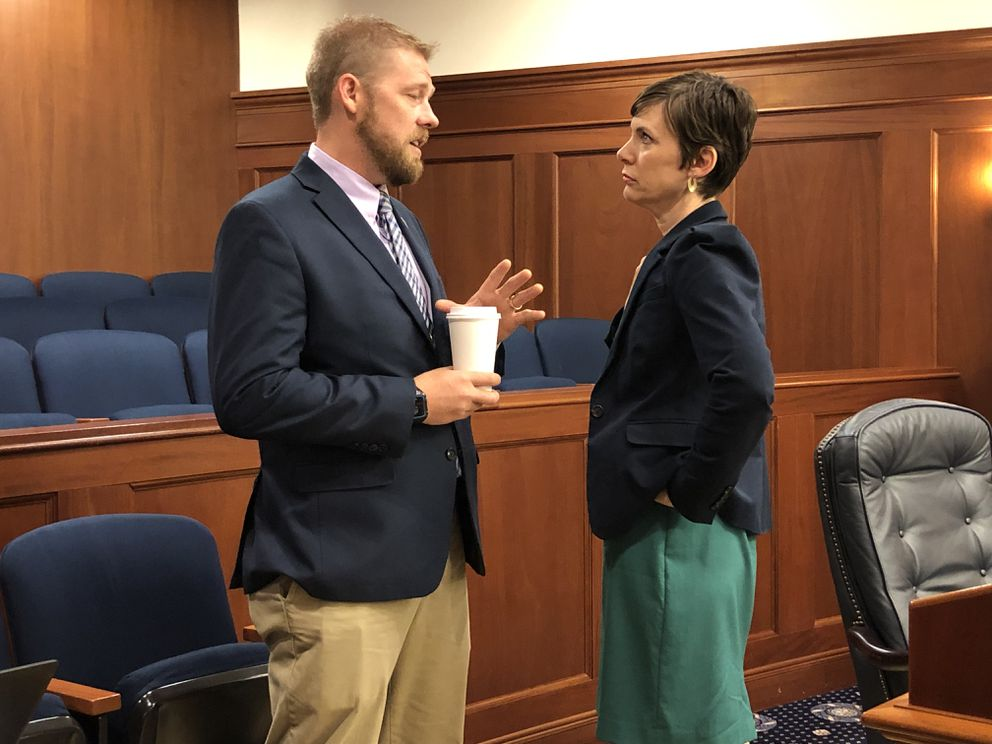 Rep. Josh Revak, R-Anchorage, talks to Rep. Ivy Spohnholz, D-Anchorage, before their Senate Bill 2002 vote on Monday morning, July 22, 2019 in the Alaska State Capitol at Juneau. (James Brooks / ADN)