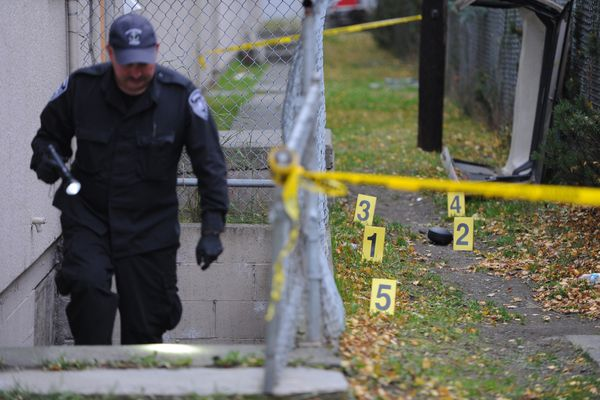 Anchorage Police Sgt. Mark Bakken investigates the scene of a fatal shooting in Spenard on Wednesday morning, Oct. 11, 2017. (Bill Roth / Alaska Dispatch News)
