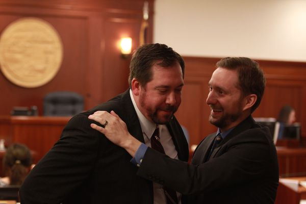 Anchorage independent Rep. Jason Grenn hugs Bethel Democratic Rep. Zach Fansler after Fansler gave a speech on the House floor supporting legislation to reduce dividends and restructure the Alaska Permanent Fund to help fill the state's massive budget deficit. The bill was approved in a 22-18 vote at the Capitol on Wednesday, April 12, 2017. (Nathaniel Herz / Alaska Dispatch News)