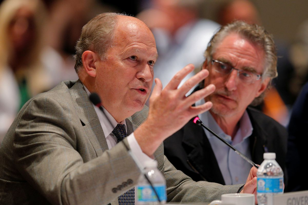 "Alaska Gov. Bill Walker speaks as North Dakota Gov. Doug Burgum listens at the ""Curbing the Opioid Epidemic"" session at the National Governors Association summer meeting in Providence, Rhode Island, on July 13. REUTERS/Brian Snyder"