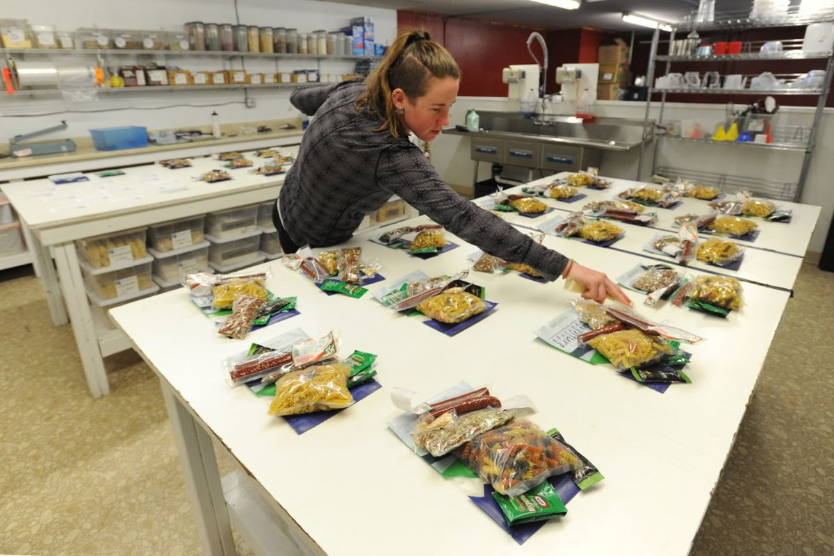 Kitchen manager Hillary Hafner assembles pasta dinner packets on Wednesday at Adventure Appetites inSouth Anchorage. The company was preparing for customers heading outdoors for the Memorial Day weekend. (Erik Hill / Alaska Dispatch News)